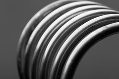 Aluminum spiral isolated on gray background Royalty Free Stock Photography
