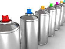 Aluminum spray cans with different colored nozzles Royalty Free Stock Photo