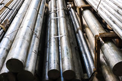 Aluminum. Stacked aluminum metal pipes. Heavy industry production Stock Images