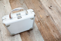 Aluminum suitcase standing on wooden floor Stock Photography
