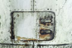 Aluminum surface of the aircraft fuselage. Royalty Free Stock Photo