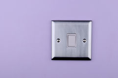 Aluminum switch plate on wall Royalty Free Stock Photo