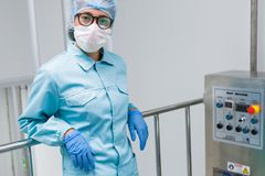 The operator checks the equipment for the production of sterile Royalty Free Stock Images