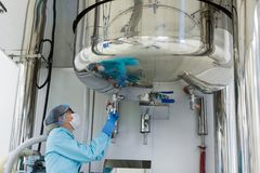 The operator checks the equipment for the production of sterile Stock Photo