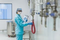 The operator checks the equipment for the production of sterile Royalty Free Stock Image