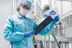 The operator checks the equipment for the production of sterile Stock Image