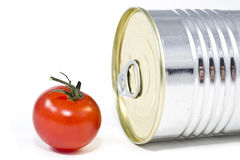Aluminum tin can and tomato Royalty Free Stock Image