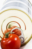 Aluminum tin can and tomato Royalty Free Stock Photos
