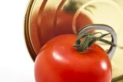 Aluminum tin can and tomato Stock Photos