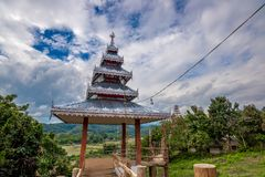 The aluminum top roof of temple decoration in Thailand. Buddhism trust Stock Photo
