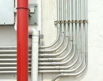 Aluminum tubing for wire protection lined up Royalty Free Stock Photo