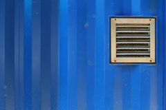 Aluminum ventilation on blue cargo container. Wall Royalty Free Stock Photos