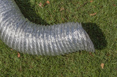 Aluminum ventilation pipe on green grass for temporary use i Stock Images