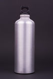 Aluminum water bottle on dark background Royalty Free Stock Image