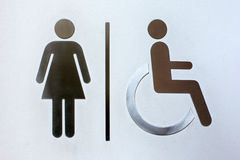 Aluminum woman and cripple toilet signs Royalty Free Stock Images