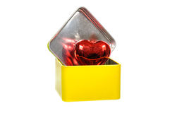 Aluminum yellow box with red heart Royalty Free Stock Photo