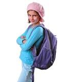 Alumno de la escuela primaria con la mochila y los libros Imagen de archivo libre de regalías