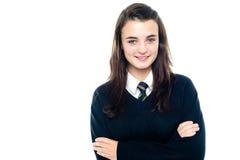 Alumno joven confidente en uniforme Imágenes de archivo libres de regalías