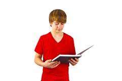 Alumno lindo que hace la preparación para Imagen de archivo