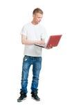 Alumno que sostiene un ordenador portátil Fotografía de archivo
