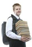 Alumno sonriente con los libros de texto Foto de archivo