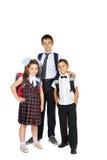 Alumnos con los bolsos de escuela Imágenes de archivo libres de regalías