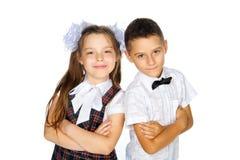 Alumnos escolar y muchacha elementales Foto de archivo