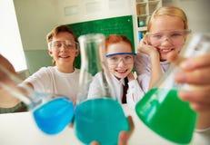 Alumnos felices Foto de archivo libre de regalías