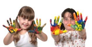 Alumnos felices que pintan con las manos Foto de archivo libre de regalías