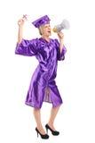 Aluno diplomado fêmea que fala em um megafone Imagens de Stock Royalty Free