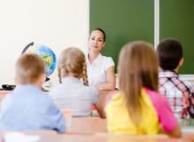 Alunos na sala de aula na lição Imagem de Stock Royalty Free