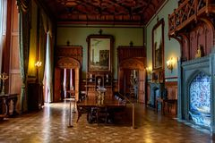 ALUPKA, RUSSIA - MARCH 21, 2013: Interior of room in Vorontsov Palace in Crimea. ALUPKA, RUSSIA - MARCH 21, 2013: Beautiful wooden interior of big room with stock image
