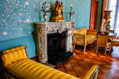 ALUPKA, RUSSIA - MARCH 21, 2013: Interior of blue living room in Vorontsov Palace in Crimea. ALUPKA, RUSSIA - MARCH 21, 2013: Beautiful interior of blue living stock photo