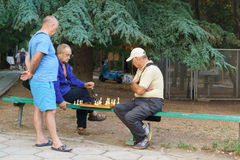 ALUSHTA, CRIMEA, RUSSIA - SEPTEMBER 20.2015: Pensioners play chess in the Park Stock Image