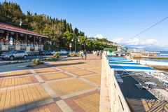 People on beach along embankment in Alushta Royalty Free Stock Image