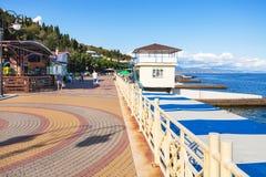 Tourists walk on embankment in Alushta city Stock Image