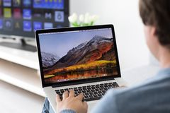 Backgrounds MacOS High Sierra in the screen of MacBook Pro. Alushta, Russia - June 8, 2017: Backgrounds MacOS High Sierra in the screen of MacBook Pro Royalty Free Stock Photo