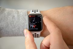 Man hand with Apple Watch Series 4 with Heart Rate. Alushta, Russia - November 6, 2018: Man hand with Apple Watch Series 4 with Heart Rate on the screen. Apple royalty free stock photography