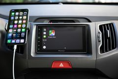 Car Play on multimedia system with Google Maps on screen Royalty Free Stock Photography