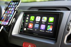 Car Play on the multimedia system with Google Maps Royalty Free Stock Image