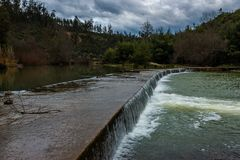 Alva river small dam, Penacova, Portugal Royalty Free Stock Images