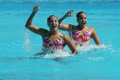 Alvarez Piedrahita and  Arango Estrada  of Colombia compete during the synchronized swimming duet free routine preliminary round Royalty Free Stock Photos