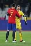 Alvaro Morata and Vlad Chiriches. Alvaro Borja Morata Martin hugs Vlad Chiriches after the friendly match between Romania and Spain, played at Cluj Arena Stadium stock photography