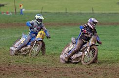 Grasstrack riders on corner. ALVELEY, UK - OCTOBER 1: A pair of solo riders competing in the autumn grasstrack meeting hosted by Bewdley MCC take the top corner Stock Image