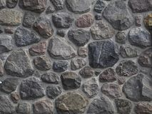 Alvenaria de pedra natural, parede feita na pedra da rocha foto de stock royalty free