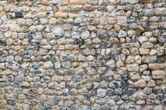 Alvenaria velha do fundo com as pedras da cor diferente Fotografia de Stock