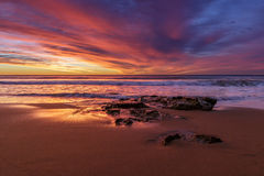 Alvorecer da praia de Warriewood Imagens de Stock