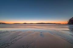 Alvorecer na praia Foto de Stock Royalty Free