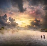 Alvorecer sobre o lago Fotografia de Stock Royalty Free