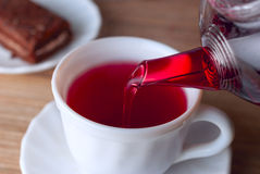 Alwaysis from tea hibiscus tea. Poured from the kettle hibiscus tea Stock Photos